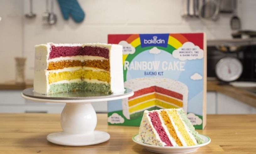 a finished rainbow cake and the box in the background