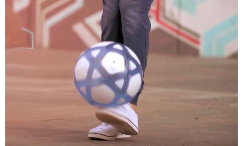 a foot kicking up the smart ball
