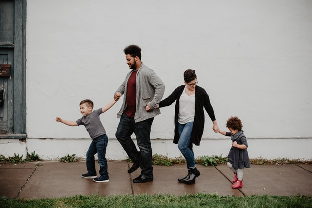 family holding hands in a line